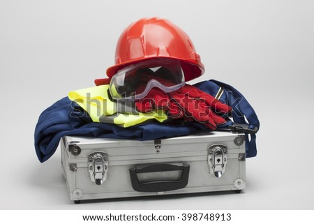 Safety equipment set, close up on dove grey - stock photo