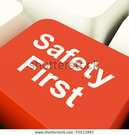 Safety First Computer Key Showing Caution Protection Or Hazards - stock photo