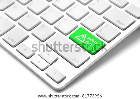 safety first concept with green key on computer keyboard - stock photo