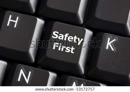 safety first concept with key on computer keyboard - stock photo