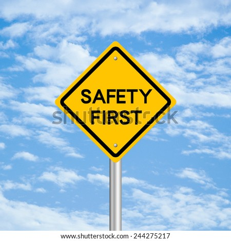 Safety first road sign with blue sky background. - stock photo