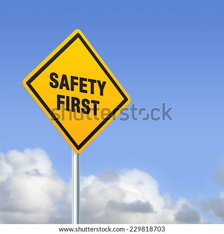 Safety first sign on blue sky - stock photo