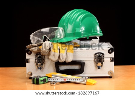 Safety gear kit close up on toolbox - stock photo