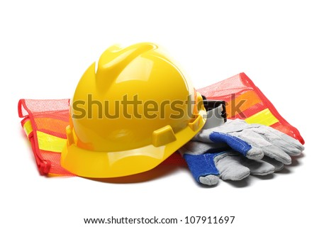 Safety gear kit close up over white. - stock photo