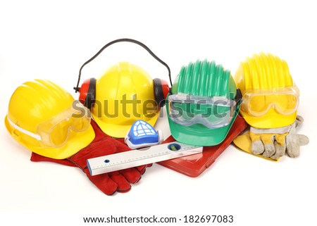 Safety gear kit - color helmets on white - stock photo
