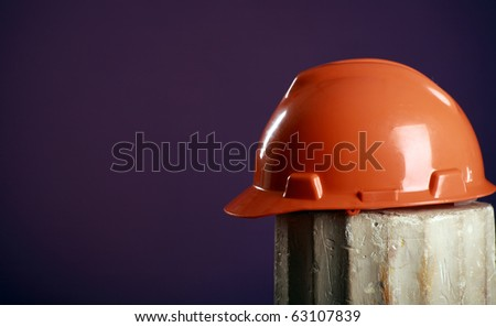 safety helmet on a purple background (room for text at left) - stock photo
