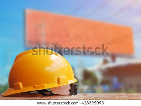 Safety helmet with construction site background - stock photo