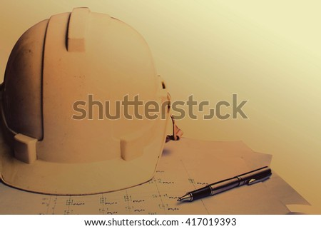 Safety helmets and drawings of old on a white background. - stock photo