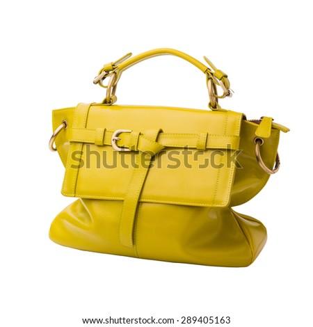 Safety lemon yellow female leather bag isolated on white background. - stock photo