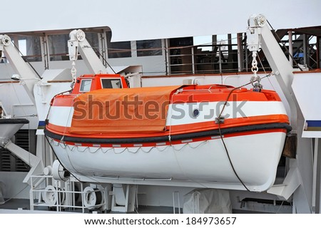 Safety lifeboat on deck of a cruise ship - stock photo