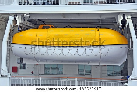 Safety lifeboat on deck of cruise ship - stock photo