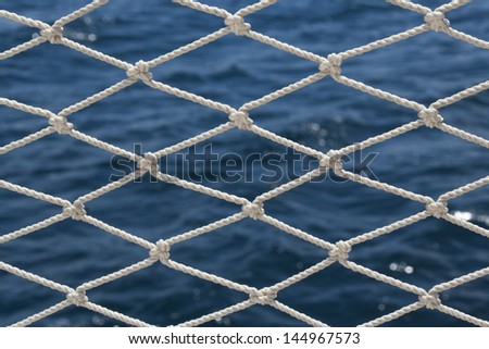 Safety net and sea background - stock photo