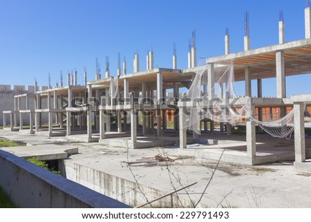 safety nets and foundations in construction of a building - stock photo