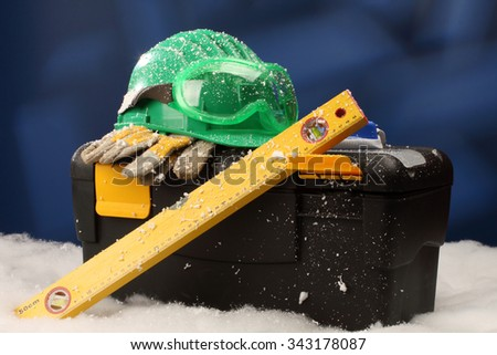 Safety New Year- protective equipment on artificial snow - stock photo