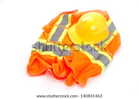 Safety vest and hard hat on white background - stock photo