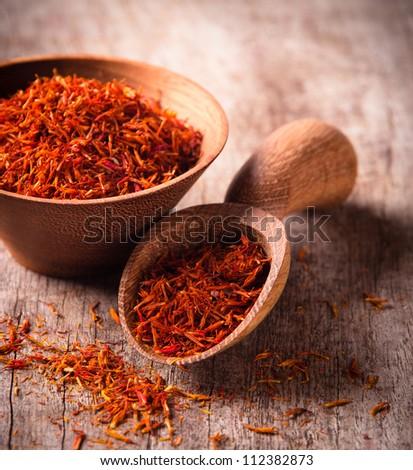 Saffron on wooden background - stock photo