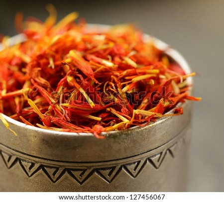 Saffron spice in metal bowl macro shot soft focus - stock photo