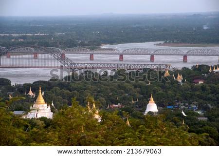 SAGAING,MYANMAR-JULY1:These Pagodas,Ayeyarwaddy river and Ava bridge has the best view from Soon U Pond Nya Shin Paya Pagoda,Sagaing hill on July 1,2014 in Sagaing Division,Mandalay,Middle of Myanmar. - stock photo