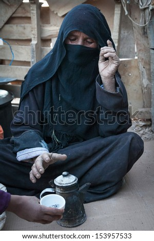 SAHARA DESERT, EGYPT - YAN 26: Portrait of the unknown old berber woman in the Sahara Desert, Egupt, Yanuary 26, 2010. Tribes of bereber wander across all North Africa from Morocco to Egypt. - stock photo