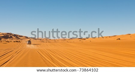 Sahara Desert Safari - Off-road vehicles driving in the Awbari Sand Sea, Libya - stock photo
