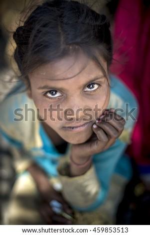 SAHARAN, INDIA - Jun 06, 2016: Young girl hand on cheek look up with sparkle big eyes. - stock photo