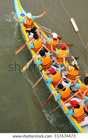 SAI GON, VIET NAM- APRIL 27: Racer in competition at boat race, Sai Gon, Viet Nam, April 27, 2013                 - stock photo
