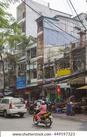 SAIGON - DECEMBER 29, 2013: Street in Ho Chi Minh City, formerly named and still also referred to as Saigon It is the largest city in Vietnam.  - stock photo