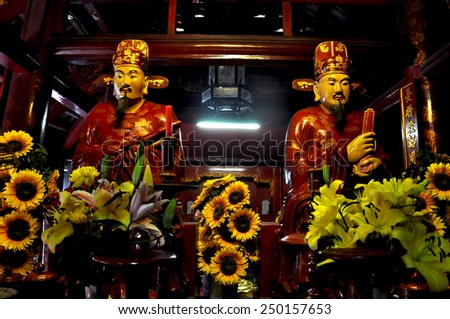 SAIGON - FEB 18: Newly renovated statues of emperors and Gods in the Jade Emperor Pagoda. On February 18, 2013, in Ho Chi Minh city (Saigon), Vietnam  - stock photo