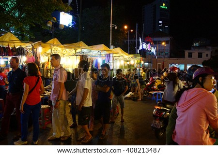 SAIGON - FEB 5, 2015 - Night market attracts diners and shoppers outside the Ben Thanh marketSaigon (Ho Chi Minh City),  Vietnam - stock photo