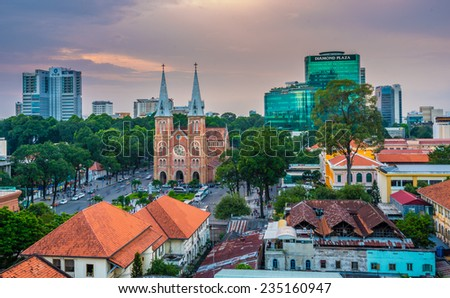 SAIGON NOTRE DAME BASILICA, HCMC, VIETNAM - December 4th, 2014 - Very nice outdoor view in sunset. The cathedral was constructed between 1863 & 1880.and has become a very famous building in HCMC.  - stock photo