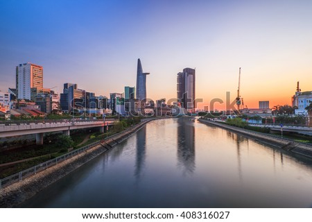 SAIGON, VIETNAM - APRIL 20, 2016: Top view of Saigon River at night time. Saigon River (the length of 256 kilometers) is most important to Ho Chi Minh City as it is the main water supply. - stock photo