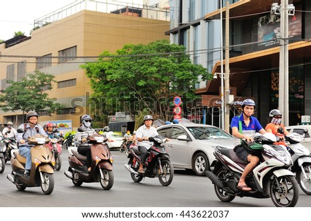 Saigon, Vietnam - Feb 25,2015: Road Traffic in Saigon (Ho Chi Minh City), Vietnam. Ho Chi Minh is the biggest city in Southern of Vietnam. - stock photo
