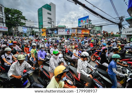 Saigon, Vietnam - June 15: Road Traffic on June 15, 2011 in Saigon (Ho Chi Minh City), Vietnam. Ho Chi Minh is the biggest city in Southern of Vietnam. - stock photo
