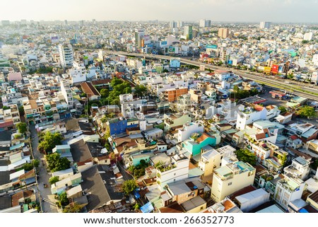SAIGON, VIETNAM - NOVEMBER 16, 2014. Ho Chi Minh city (or Saigon) skyline in sunset, Vietnam. Ho Chi Minh city is the biggest city in Vietnam. - stock photo