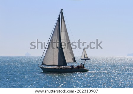 Sail boat in navegation close to the coast of Alicante city - stock photo