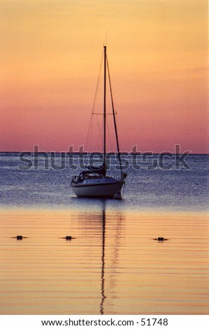 Sail boat on Ephrem Bay during a sunset in Door County Wisconsin - stock photo