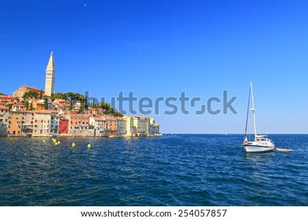 Sail boats in front of Venetian town of Rovinj, Croatia - stock photo