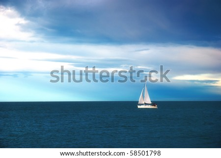 sail into calm blue sea - stock photo
