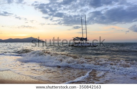 sail mooring beside the beach in twilight time - stock photo