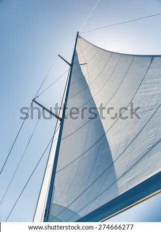 Sail on sky background, part of luxury water transport, summer adventure on sailboat, freedom and active lifestyle concept - stock photo