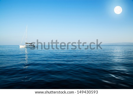 Sailboat and full moon - stock photo