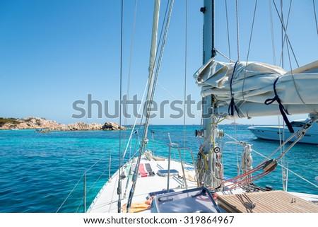 Sailboat at anchor, Porto della Madonna, Maddalena Archipelago, Sardinia, Italy - stock photo
