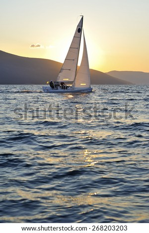 Sailboat at sunset - stock photo