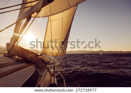 Sailboat crop during the regatta at sunset ocean, instagram toning
