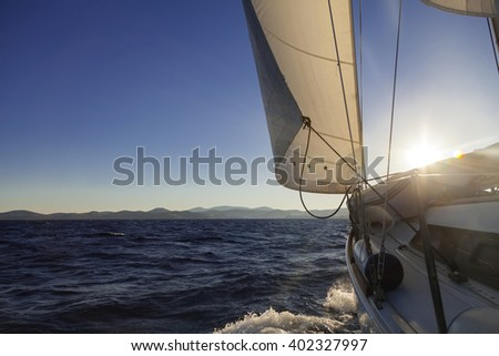 Sailboat crop during the regatta at sunset ocean, instagram toning - stock photo