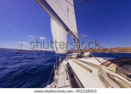 Sailboat crop during the regatta near greek islands - stock photo