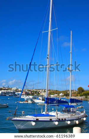 Sailboat floating in the bay - stock photo