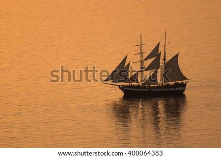 Sailboat in the Aegean sea near Santorini island, Thira, Cyclades, Greece - stock photo
