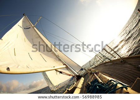 Sailboat in the open sea - stock photo