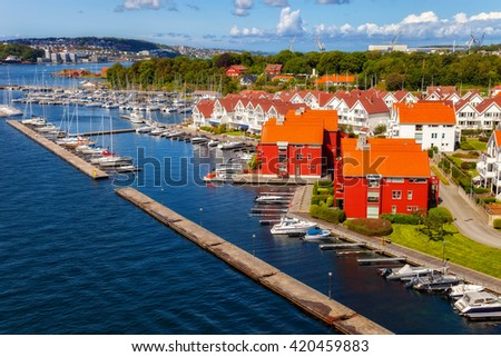 Sailboat marina with many moored sail yachts in the port of Stavanger, Norway. - stock photo